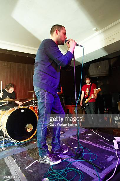 Mark Devine, James Graham and Johnny Docherty of The Twilight Sad perform on stage at The Harley on March 27, 2010 in Sheffield, England.