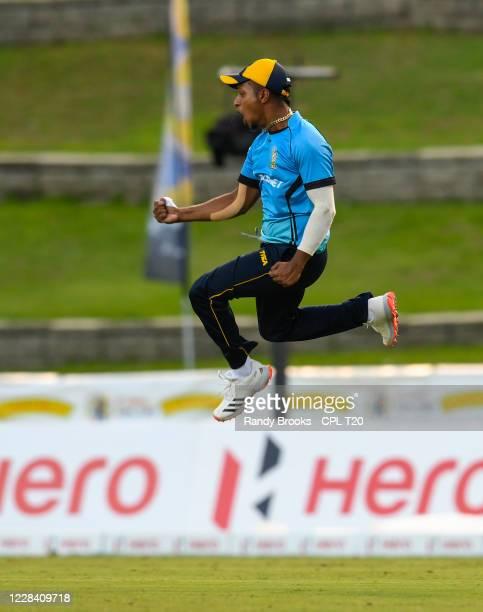 Mark Deyal of St Lucia Zouks celebrates taking the catch to dismiss Nicholas Pooran of Guyana Amazon Warriors during the Hero Caribbean Premier...