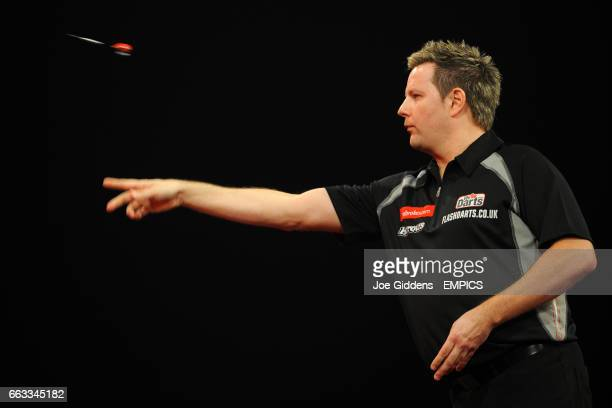 Mark Dudbridge in action against Mensur Suljovic during their second round match