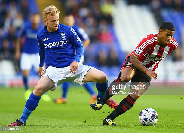 Mark Duffy of Birmingham City tangles with Liam Bridcutt of Sunderland during the Capital One Cup second round match between Birmingham City and...