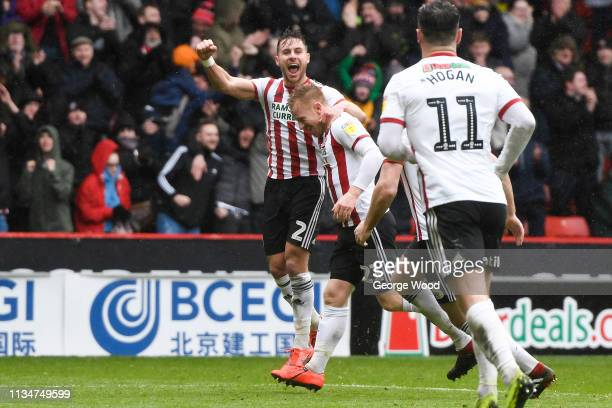 Mark Duffy of Sheffield United celebrates after scoring his team's second goal with George Boldock of Sheffield United during the Sky Bet...