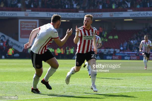 Mark Duffy of Sheffield United celebrates with a team mate after scoring their team's first goal during the Sky Bet Championship match between...