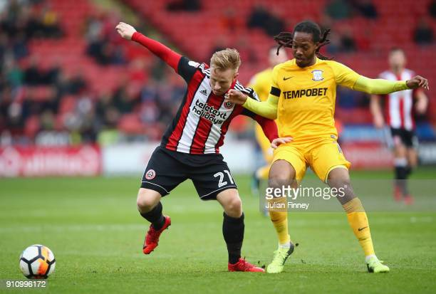 Mark Duffy of Sheffield United is challenged by Daniel Johnson of Preston North End during The Emirates FA Cup Fourth Round match between Sheffield...