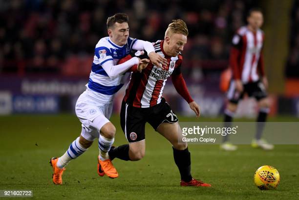 Mark Duffy of Sheffield United is challenged by Josh Scowen of Queens Park Rangers during the Sky Bet Championship match between Sheffield United and...