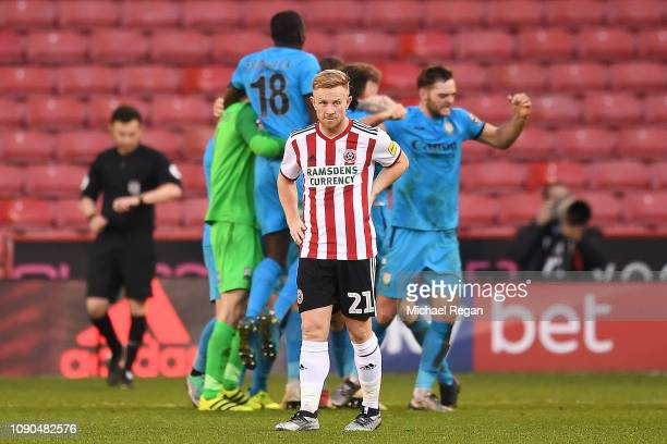 Mark Duffy of Sheffield United looks dejected as the Barnet players celebrate their 10 victory at the final whistle during the FA Cup Third Round...