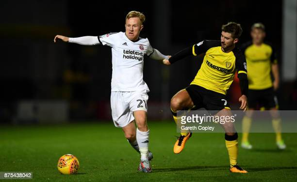 Mark Duffy of Sheffield Utd is tackled by Luke Murphy of Burton during the Sky Bet Championship match between Burton Albion and Sheffield United at...