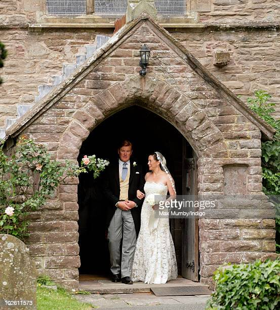 Mark Dyer and Amanda Kline leave St Edmund's Church after their wedding on July 3 2010 in Abergavenny Wales