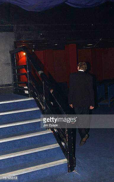 Mark E Smith of The Fall leaves the stage after performing at the Hammersmith Palais on April 1 2007 in London This was the last scheduled concert at...