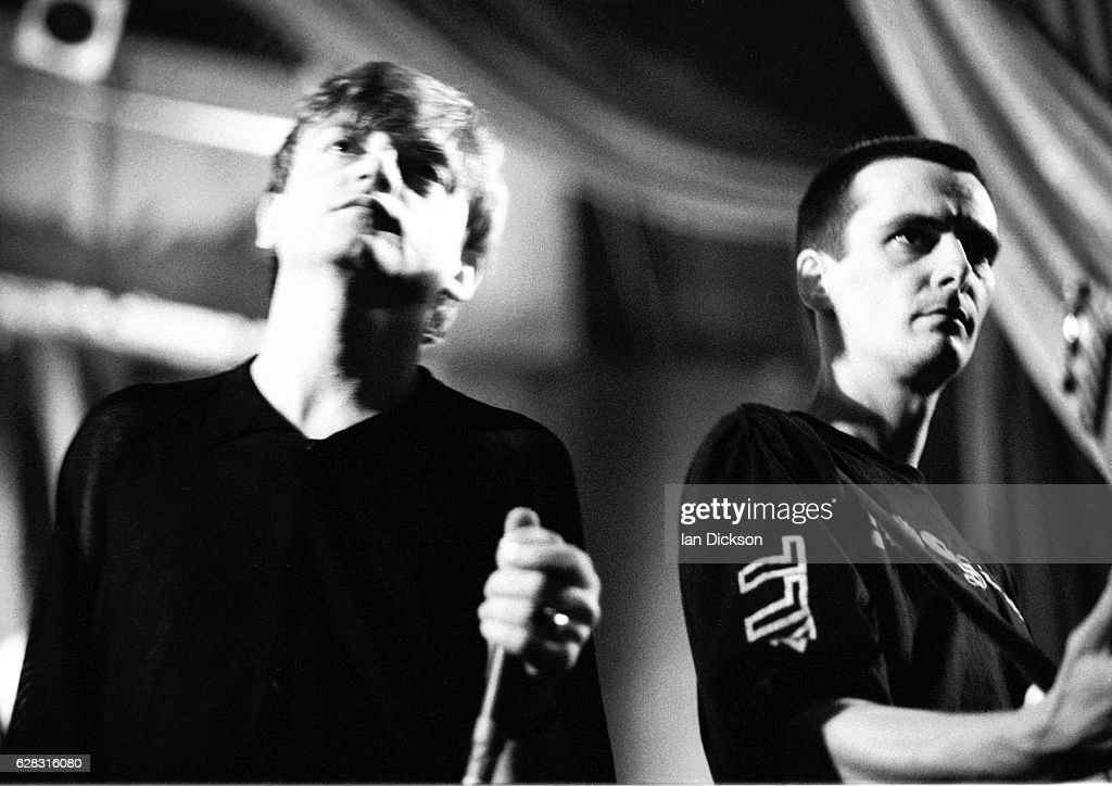 Mark E Smith of The Fall performing on stage at Kilburn National, London, 21 March 1990.