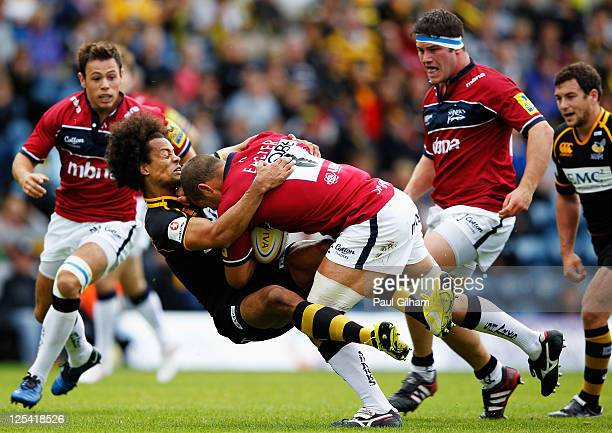 Mark Easter of Sale Sharks is tackled by Richard Haughton of London Wasps during the AVIVA Premiership match between London Wasps and Sale Sharks at...