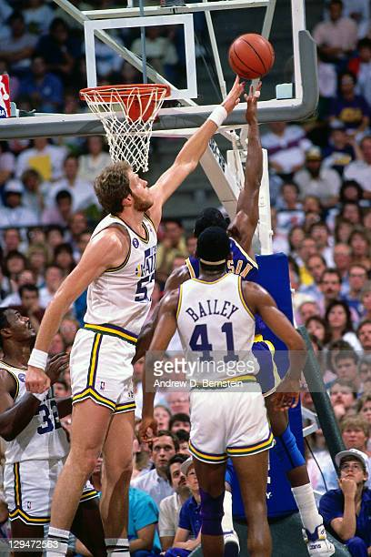 Mark Eaton of the Utah Jazz blocks a shot attempt by Magic Johnson of the Los Angeles Lakers circa 1987 at the Great Western Forum in Inglewood...