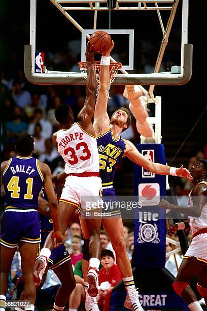 Mark Eaton of the Utah Jazz blocks a shot by Otis Thorpe of the Houston Rockets circa 1987 at The Summit in Houston Texas NOTE TO USER User expressly...
