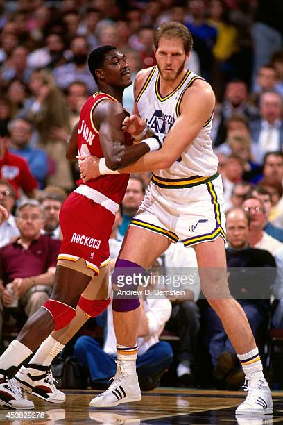 Mark Eaton of the Utah Jazz defends against Hakeem Olajuwon of the Houston Rockets circa 1990 at the Salt Palace in Salt Lake City Utah NOTE TO USER...