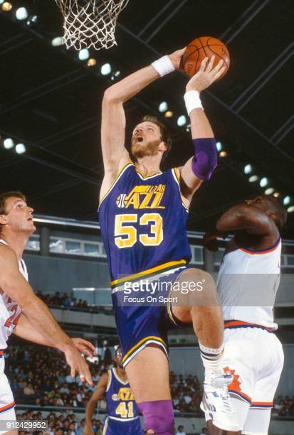 Mark Eaton of the Utah Jazz goes up for a slam dunk against the Phoenix Suns during an NBA basketball game circa 1989 at the Arizona Veterans...
