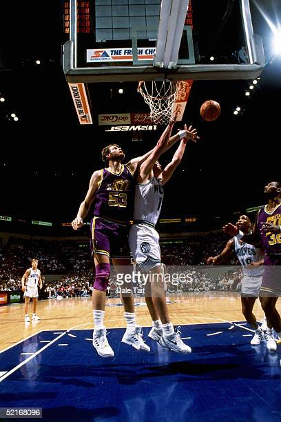Mark Eaton of the Utah Jazz goes up to block a shot against the Minnesota Timberwolves during a NBA Game in 1990 at Target Center in Minneapolis...