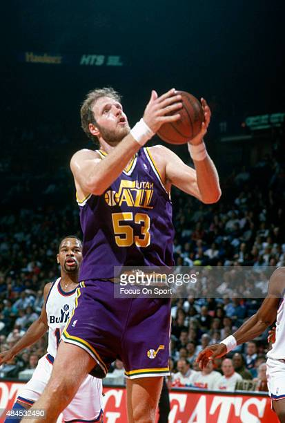Mark Eaton of the Utah Jazz grabs a rebound against the Washington Bullets during an NBA basketball game circa 1990 at the Capital Centre in Landover...