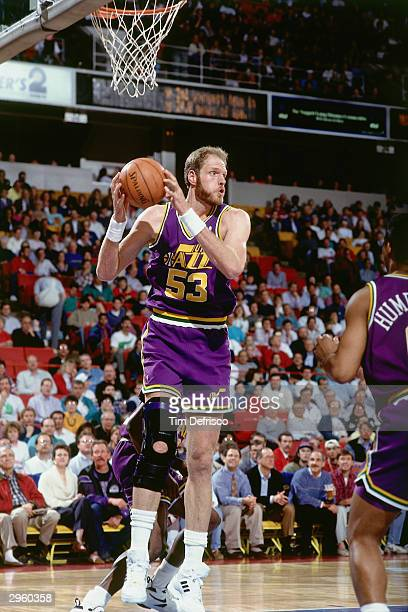Mark Eaton of the Utah Jazz grabs a rebound during an NBA game circa 1993 NOTE TO USER User expressly acknowledges and agrees that by downloading and...