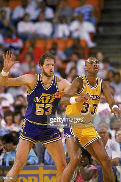 Mark Eaton of the Utah Jazz guards Kareem AbdulJabbar of the Los Angeles Lakers during an NBA game at The Salt Palace in Salt Lake City Utah in 1989