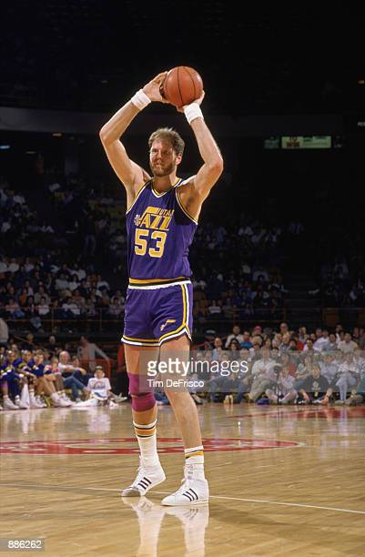 Mark Eaton of the Utah Jazz holds the ball during an NBA game against the Denver Nuggets at McNichols Sports Arena in Denver Colorado in 1989