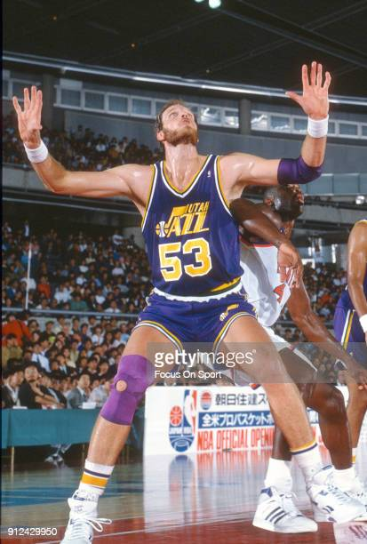 Mark Eaton of the Utah Jazz in action against the Phoenix Suns during an NBA basketball game circa 1989 at the Arizona Veterans Memorial Coliseum in...