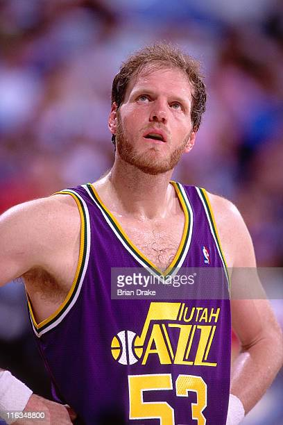 Mark Eaton of the Utah Jazz looks on against the Portland Trailblazers circa 1990 at the Veterans Memorial Coliseum in Portland Oregon NOTE TO USER...