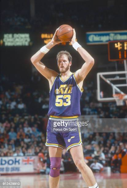 Mark Eaton of the Utah Jazz looks to pass the ball against the Chicago Bulls during an NBA basketball game circa 1989 at Chicago Stadium in Chicago...