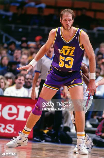 Mark Eaton of the Utah Jazz plays defense against the New Jersey Nets during a game played circa 1991 at the Brendan Byrne Arena in East Rutherford...