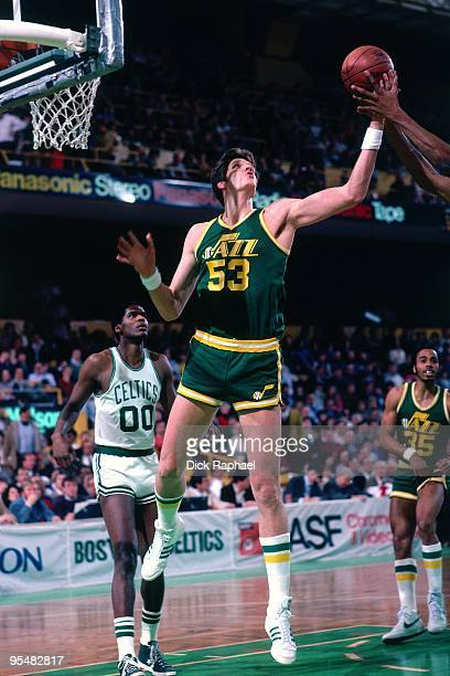 Mark Eaton of the Utah Jazz rebounds against the Boston Celtics during a game played in 1984 at the Boston Garden in Boston Massachusetts NOTE TO...