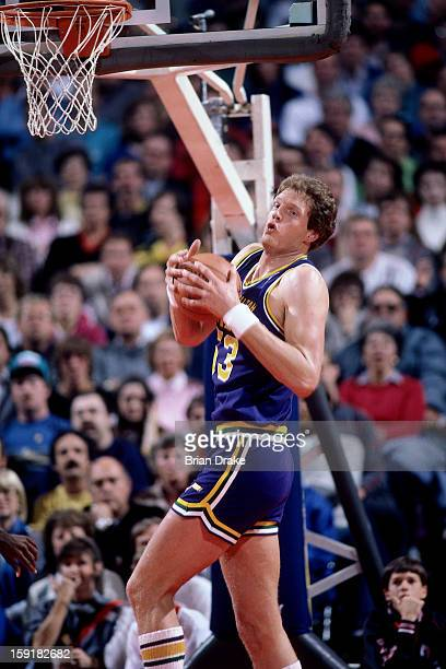 Mark Eaton of the Utah Jazz rebounds against the Portland Trailblazers at the Veterans Memorial Coliseum in Portland Oregon circa 1987 NOTE TO USER...