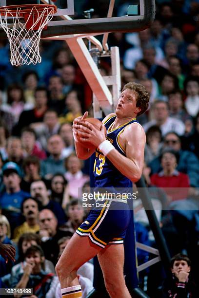 Mark Eaton of the Utah Jazz rebounds against the Portland Trail Blazers during a game played circa 1987 at the Veterans Memorial Coliseum in Portland...