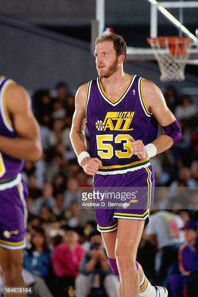 Mark Eaton of the Utah Jazz runs against the Phoenix Suns during a game played on November 2 1990 at the Tokyo Metropolitan Gymnasium in Tokyo Japan...