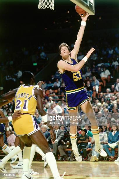 Mark Eaton of the Utah Jazz shoots a hookshot against the Los Angeles Lakers during an NBA game at The Forum circa 1985 in Los Angeles California...