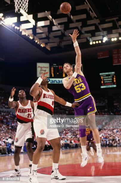 Mark Eaton of the Utah Jazz shoots against the Portland Trail Blazers during a game at Memorial Coliseum in Portland Oregon circa 1991 NOTE TO USER...