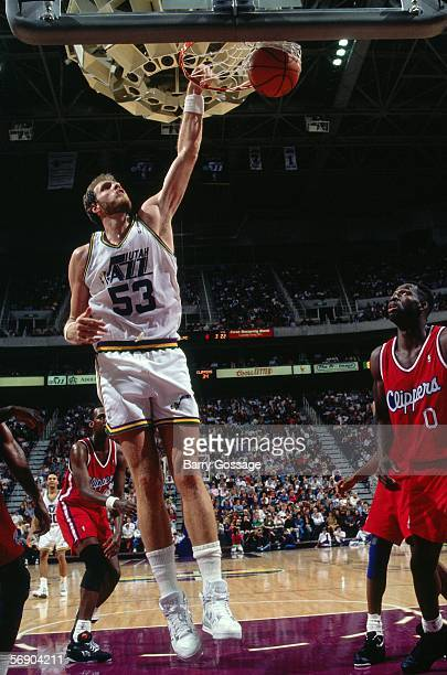 Mark Eaton#53 of the Utah Jazz goes up for a slam dunk against the Los Angeles Clippers during an NBA game at the Delta Center circa 1991 in Salt...