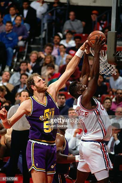 Mark Eaton#53 of the Utah Jazz goes up to block a shot against the Los Angeles Lakers during the NBA game at the LA Memorial Sports Arena circa 1990...