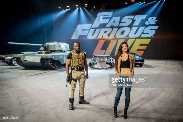 Mark Ebulue and Elysia Wren pose during the 'Fast Furious Live' technical rehearsal at NEC Arena on December 18 2017 in Birmingham England