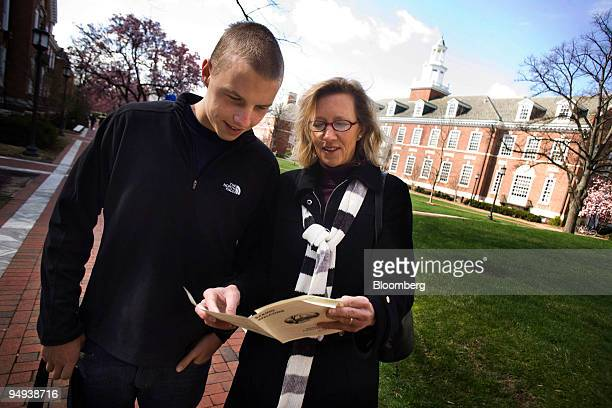 Mark Edwards aged 17 and his mother Jill Edwards tour the campus of Johns Hopkins University during a welcoming for admitted students in Baltimore...