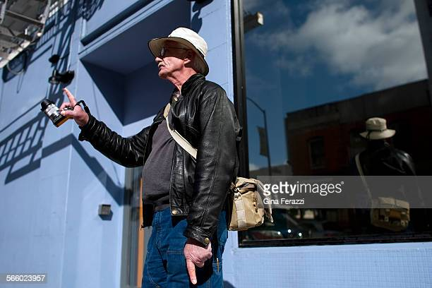 Mark Ellinger pauses to take in the views while photographing some of his favorite architecture in the Tenderloin district of San Francisco on March...