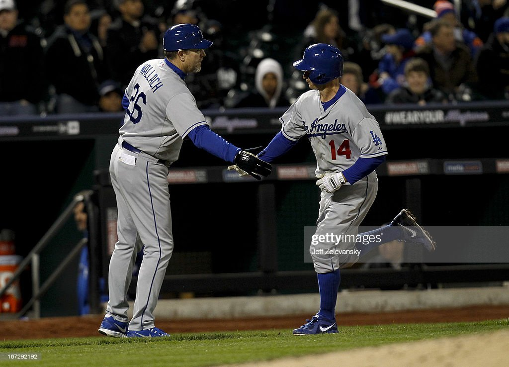Mark Ellis #14 is greeted by Tim Wallach #26 of the Los Angeles Dodgers as he rounds the bases on his solo home run in the fifth inning against the New York Mets at Citi Field in the Flushing neighborhood of the Queens borough of New York City.