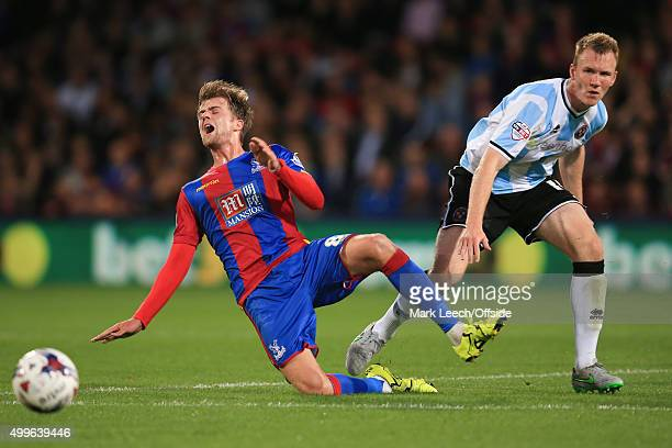 Mark Ellis of Shrewsbury Town in action with Patrick Bamford of Crystal Palace during the Capital One Cup match between Crystal Palace and Shrewsbury...