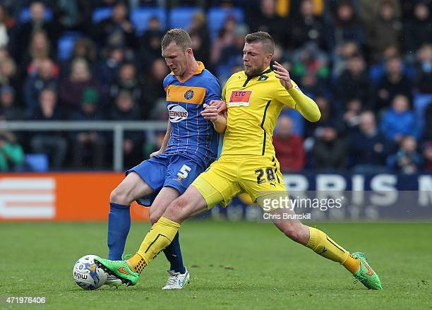 Mark Ellis of Shrewsbury Town in action with Ryan Brunt of Plymouth Argyle during the Sky Bet League Two match between Shrewsbury Town and Plymouth...