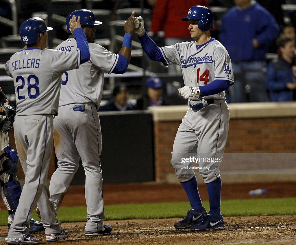 Mark Ellis #14 of the Los Angeles Dodgers is greeted by Juan Uribe #5 and Justin Sellers #28 after his three-run home run in the seventh inning against the New York Mets at Citi Field in the Flushing neighborhood of the Queens borough of New York City.