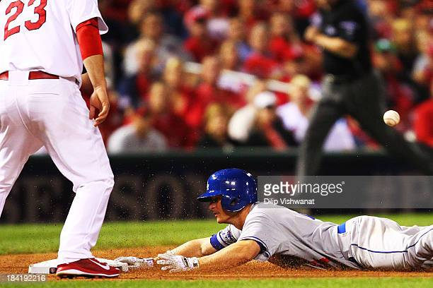 Mark Ellis of the Los Angeles Dodgers slides into third on a triple in the 10th inning against the St Louis Cardinals during Game One of the National...