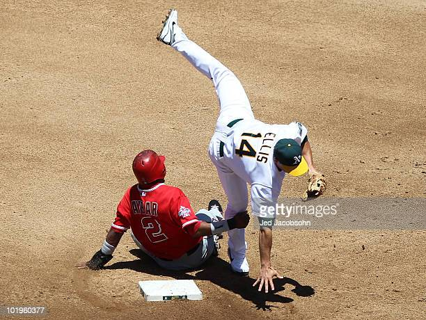 Mark Ellis of the Oakland Athletics is upended by Erick Aybar of the Los Angeles Angels of Anaheim on a double play hit by Howie Kendrick in the...