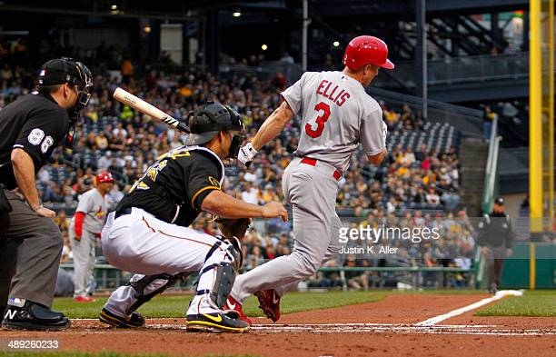 Mark Ellis of the St Louis Cardinals hits a RBI single in the second inning against the Pittsburgh Pirates during the game at PNC Park May 10 2014 in...