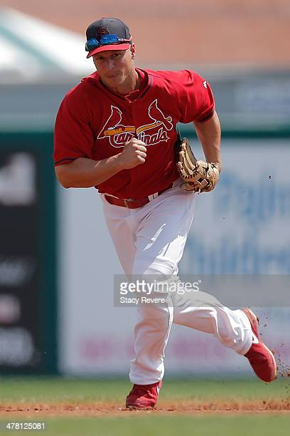 Mark Ellis of the St Louis Cardinals prepares to field a ball in the third inning of a game against the Detroit Tigers at Roger Dean Stadium on March...