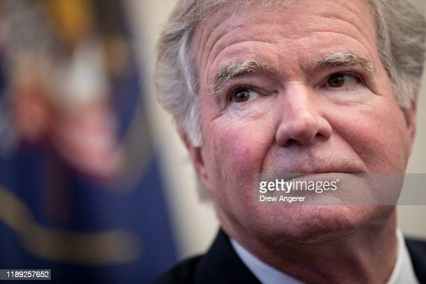 Mark Emmert, president of the National Collegiate Athletic Association , looks on during a brief press availability on Capitol Hill December 17, 2019...