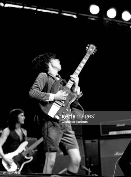 Mark Evans, Angus Young from the rock band AC/DC Live at Reading Festival In Reading, UK August 29, 1976