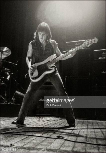 Mark Evans of AC/DC performing on stage Lyceum Theatre London United Kingdom on July 7 1976 from the Lock Up Your Daughters Tour