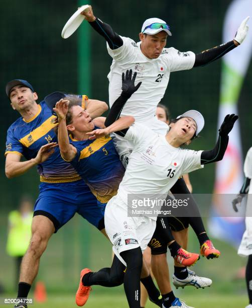 Mark Evans of Australia, Vivien Stettner of Australia, Kenjiro Kawase of Japan and Saori Inoue of Japan compete for the frisbee during the Ultimate...